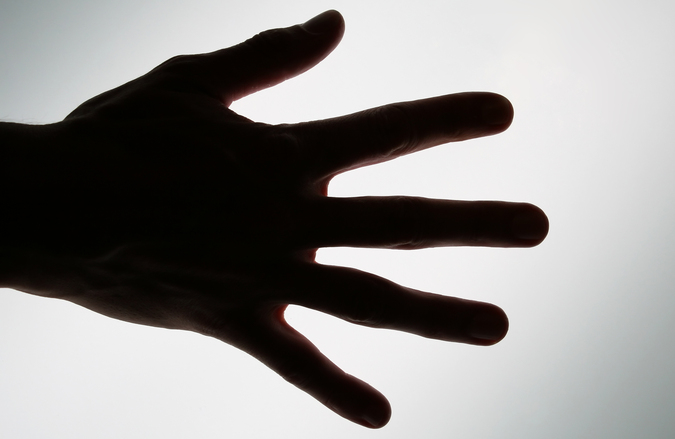 Conceptual silhouette hand, ready to take from or achieve